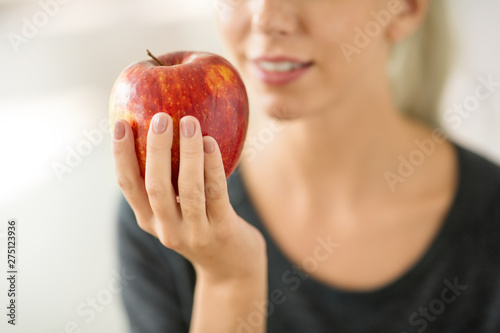 Papier Peint - food, diet and people concept - close up of woman holding ripe red apple