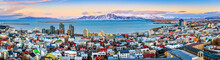 Papier Peint - Aerial panorama of downtown Reykjavik at sunset with colorful houses and snowy mountains in the background