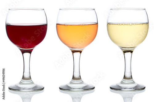 Papier Peint - Three glasses of red, rose and white wine isolated on white
