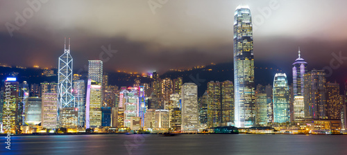 Papier Peint - Hong Kong skyline at mist over Victoria harbor