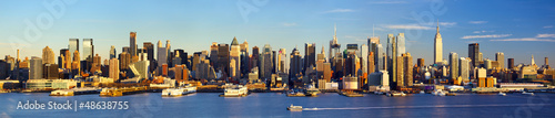 Papier Peint - Manhattan Midtown skyline panorama before sunset, New York