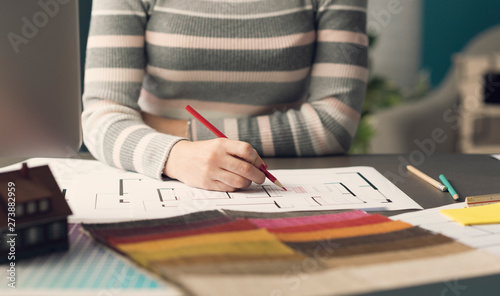 Papier Peint - Creative interior designer sketching on a house plan